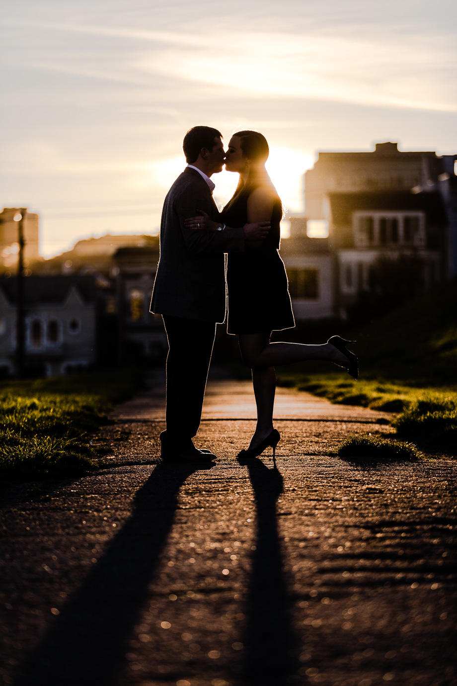 sharp contrast silhouette sunset kissing photo