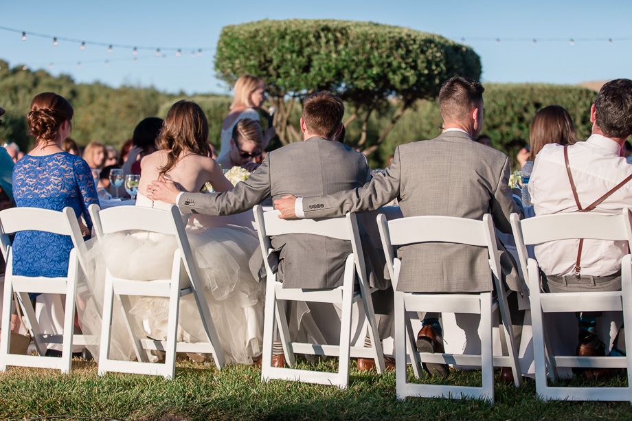 outdoor reception toast under the string lights