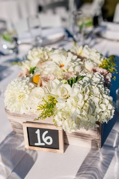outdoor rustic floral centerpiece in a wooden box