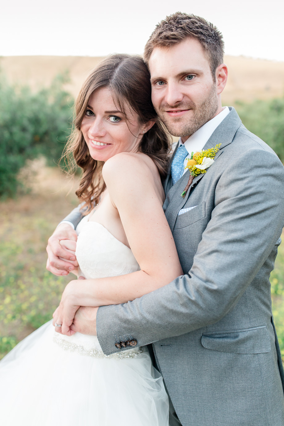 glowing bride and handsome groom portrait