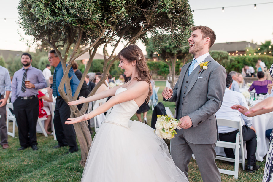 happy bride and groom at their outdoor reception - purple orchid resort