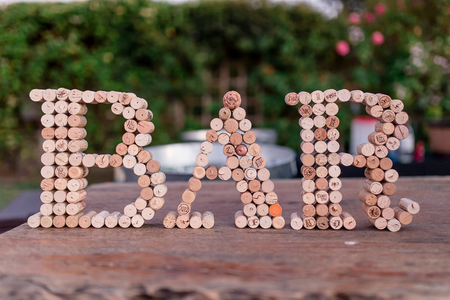 the cork bar sign handmade by bride and groom