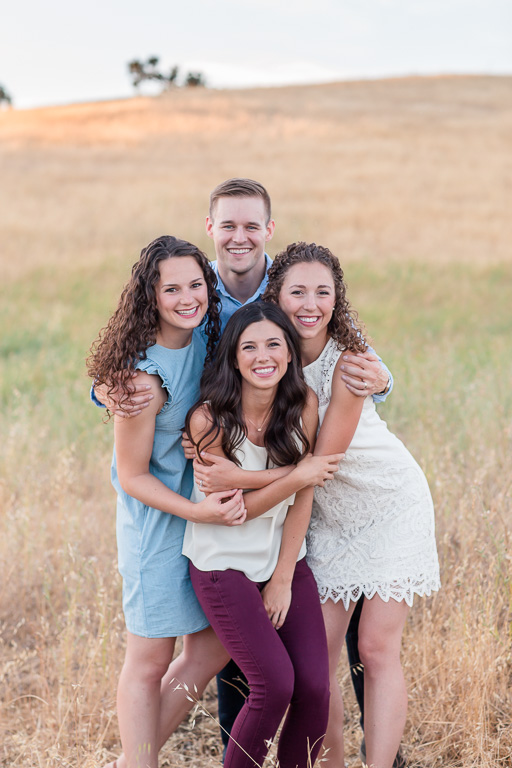 family photo in tall grassy field