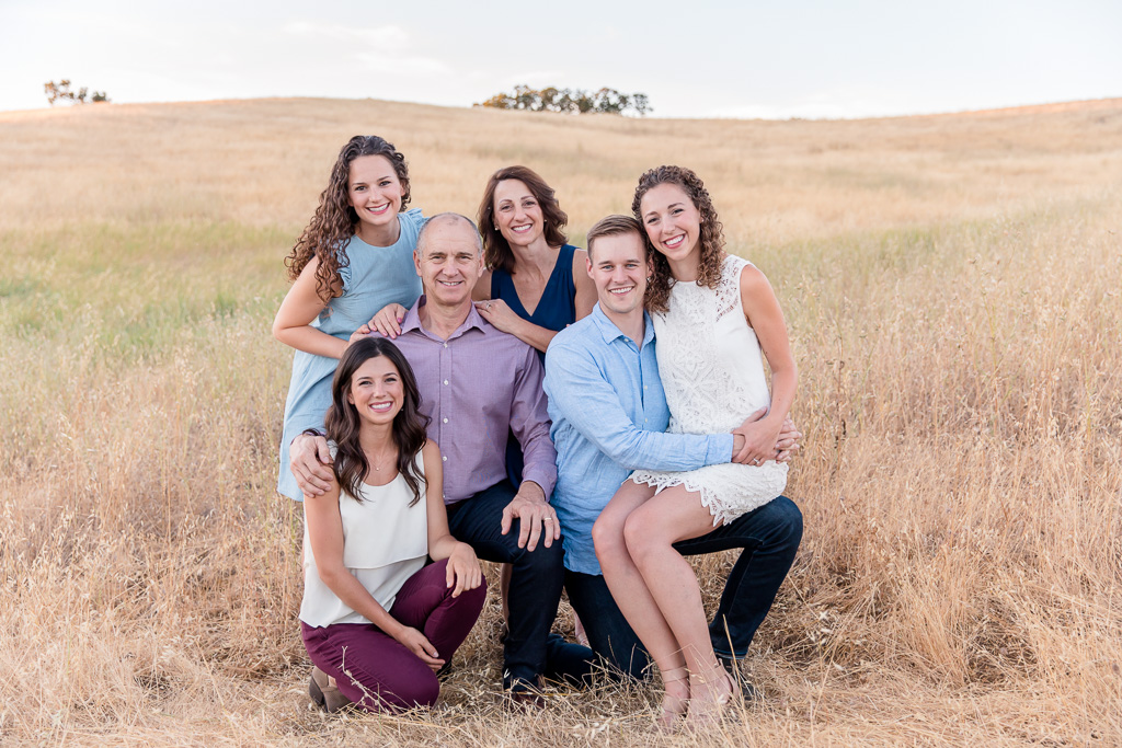 beautiful casual family photograph in a golden grassy field