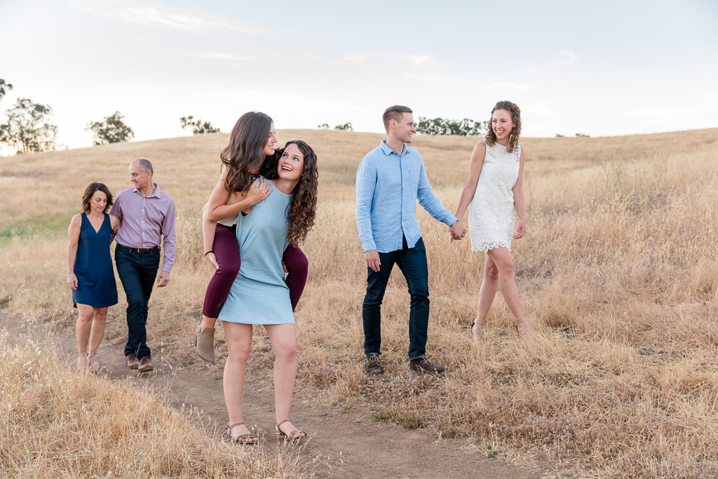 lifestyle casual family photo piggyback ride