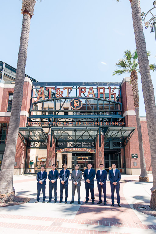 groom with groomsmen in front of AT&T Park Willie Mays Giants stadium