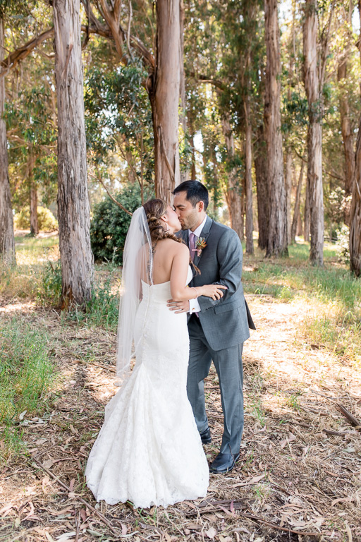 bride and groom kissing before ceremony after first look
