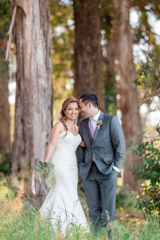 beautiful bride and groom portrait in a sunny forest