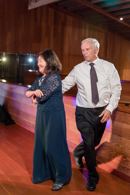 parents of the groom dancing together