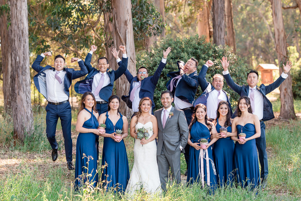 silly wedding party jumping photo with funny facial expressions