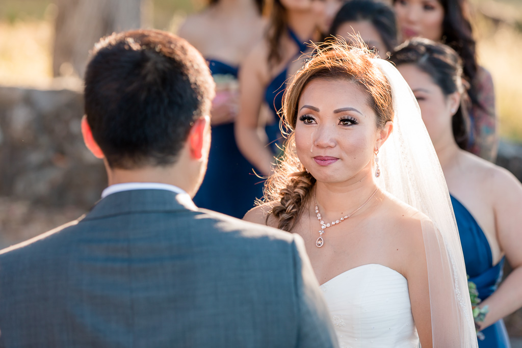 single tear rolling down bride's face during touching wedding ceremony at Coyote Point