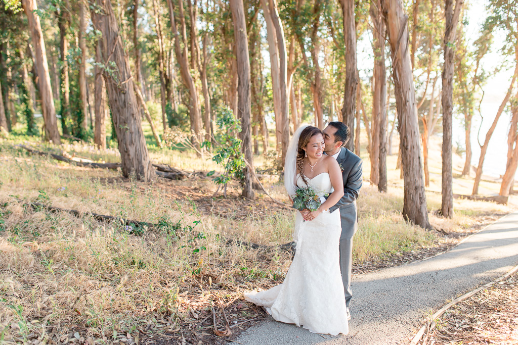 bride and groom laughing sweetly in northern California forest