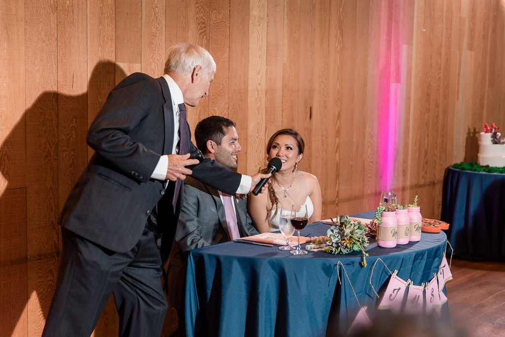 father of the groom giving toast to newlyweds