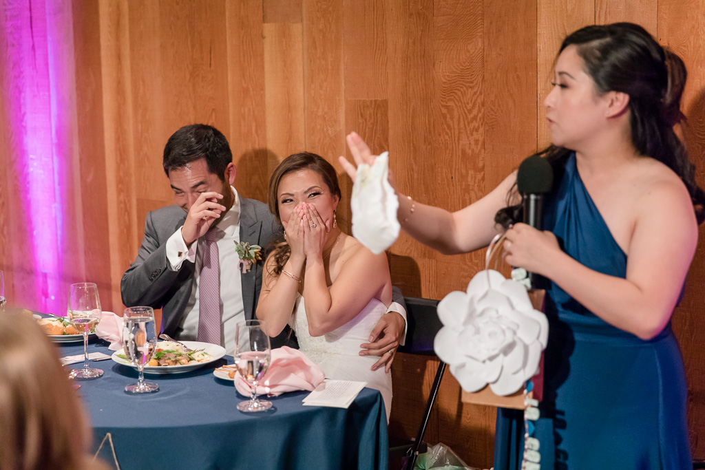 bridesmaid giving a funny speech and holding a diaper