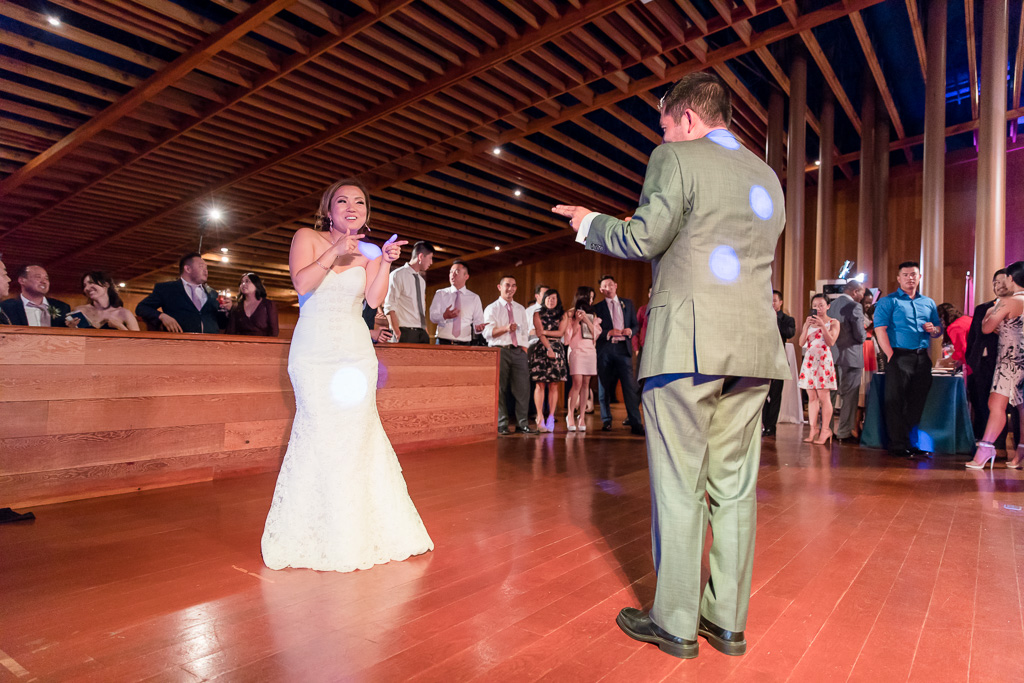 first dance between bride and groom at CuriOdyssey museum wedding