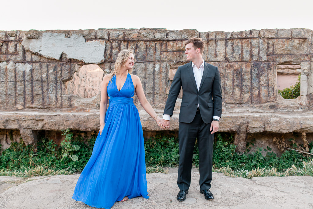engagement photo in long blue dress and black suit