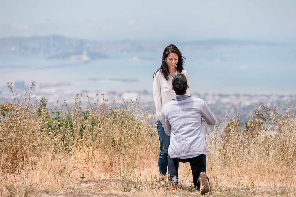 surprise proposal with San Francisco and Bay Bridge backdrop