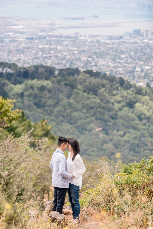 engagement photos at Grizzly Peak in Berkeley with Oakland and Bay Bridge in the distance