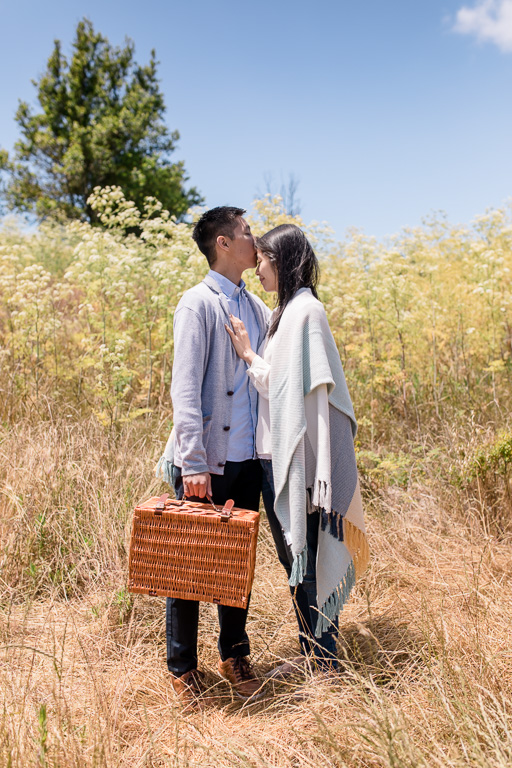 kiss on forehead in field of golden tall grass