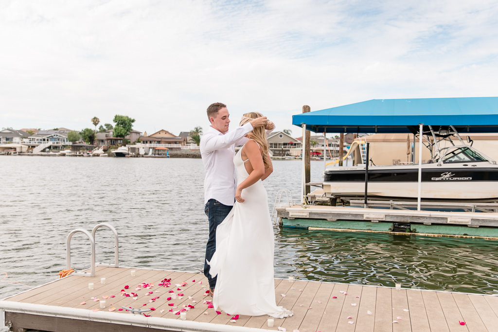 taking off blindfold on a dock and getting ready to propose