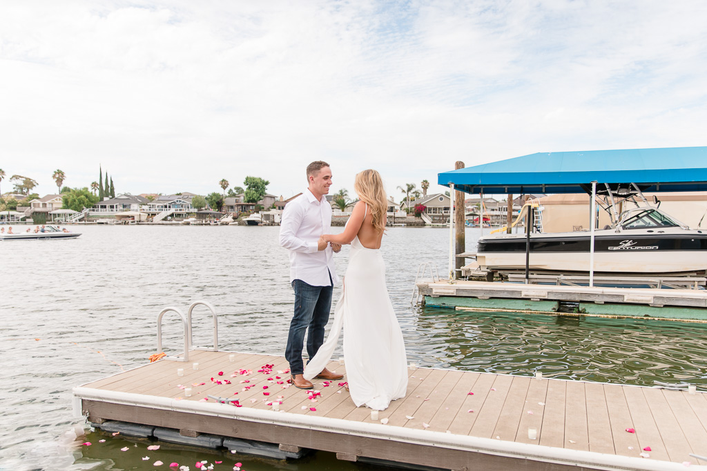surprise proposal on a lake dock