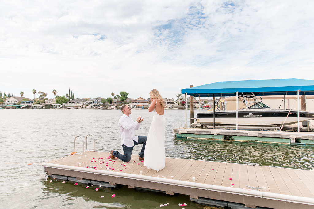 amazing surprise proposal on a boat dock