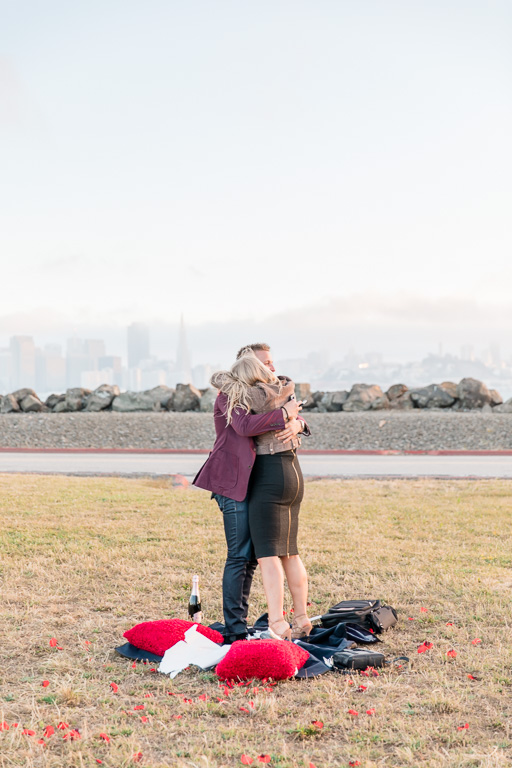 our couple is engaged in front of this stunning view of san francisco city skyline
