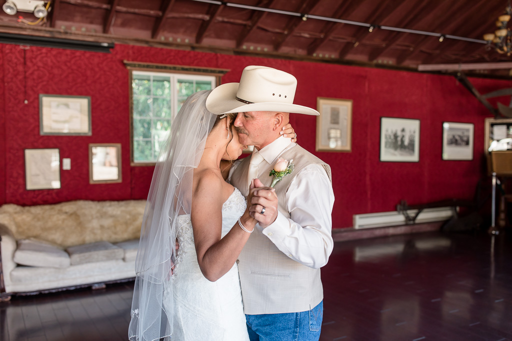 a tender moment between the bride and groom at long branch farm