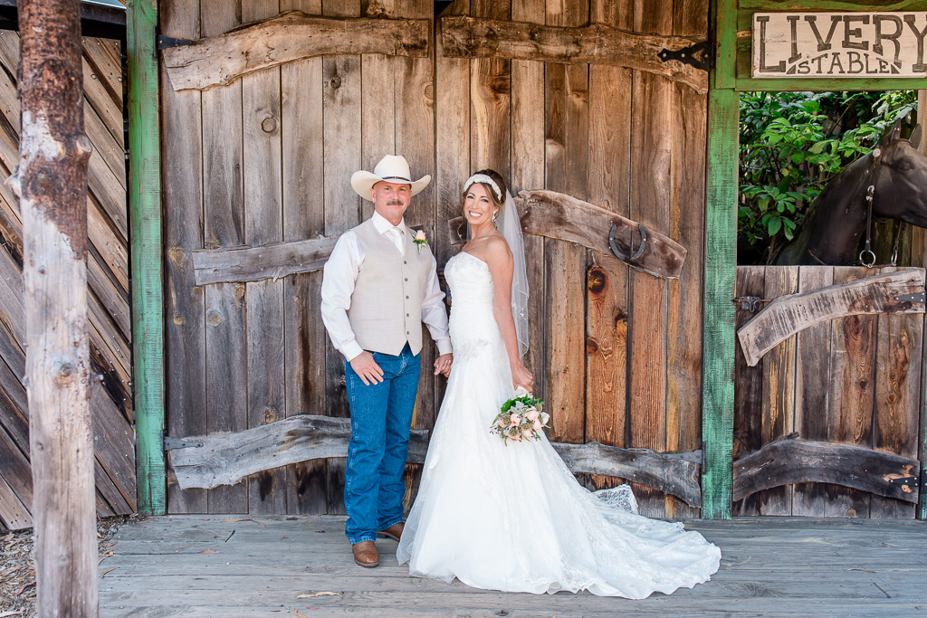 bride and groom outside the ranch door at Long Branch