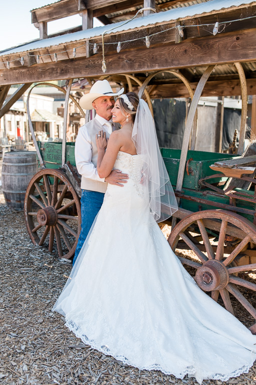 bride and groom portrait with an old wagon at long branch