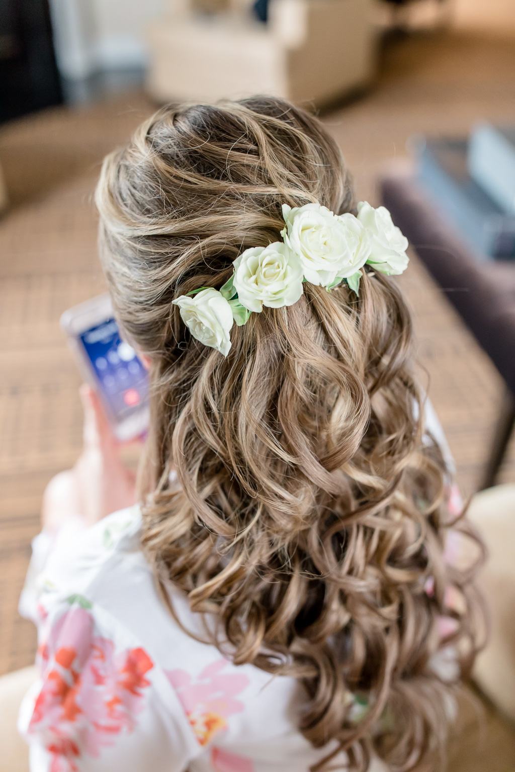 elegant and romantic half up half down bridal hair do with fresh roses