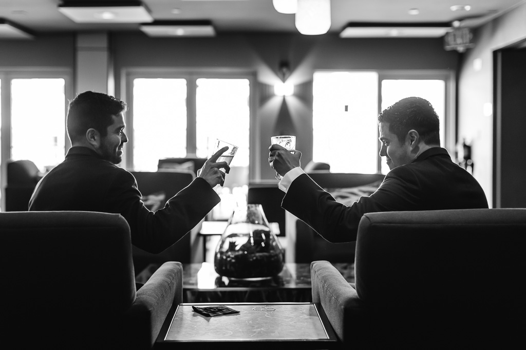 groom drinking at the bar with his best man