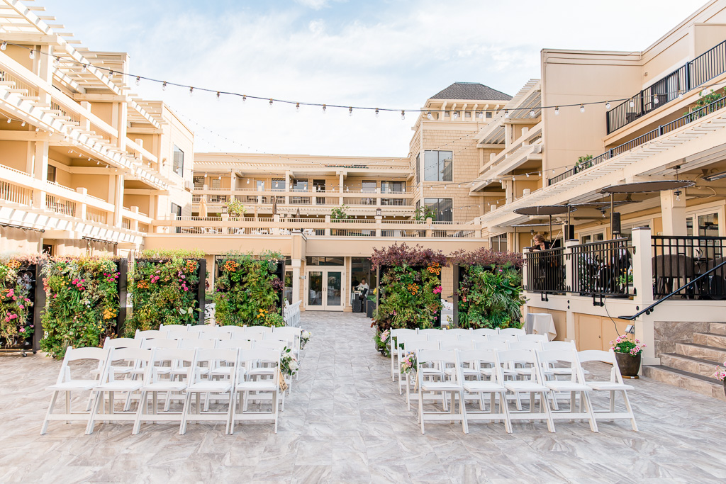 Toll House Hotel and its flower wall make a perfect backdrop for a wedding ceremony