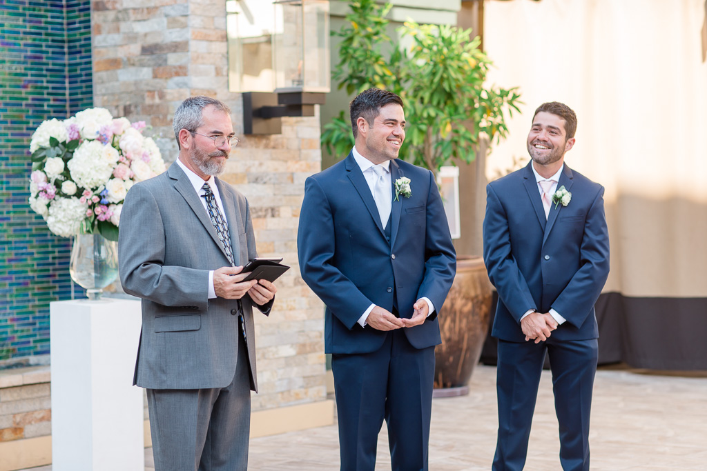 groom was happy to see his bride from the other side of the aisle