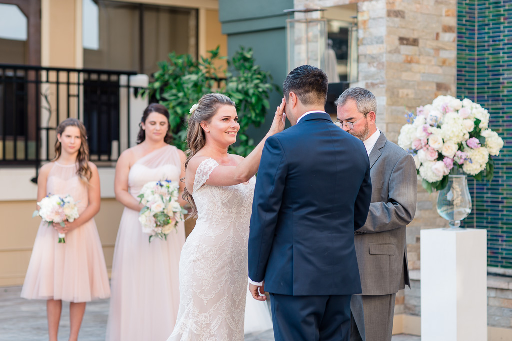 bride wiping groom's tears during the emotional Los Gatos hotel wedding ceremony