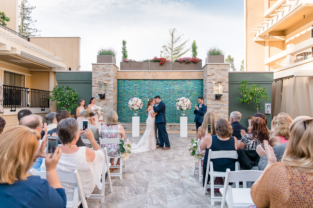 Toll House Hotel courtyard ceremony first kiss