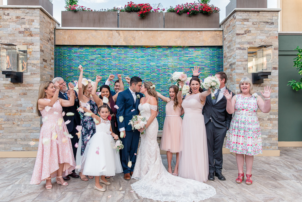 a cute family group photo with the bride and groom at the Toll House Hotel courtyard
