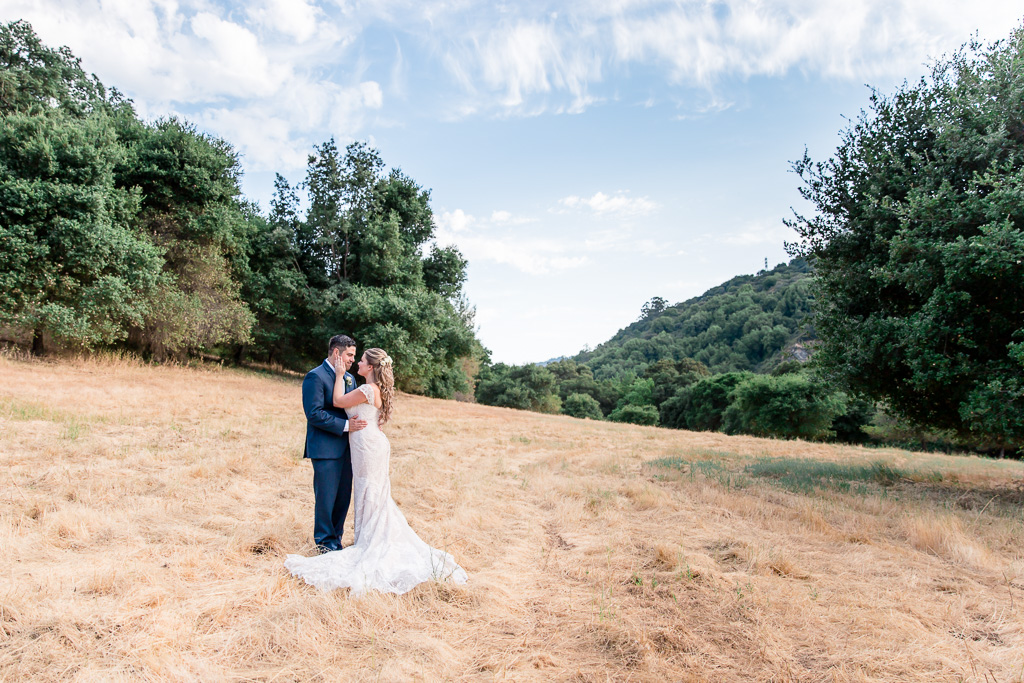 romantic wedding portrait at a grove in Los Gatos with bride in her blush off shoulder wedding gown