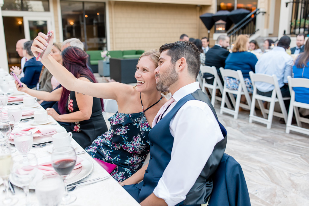 wedding guests taking cute selfies at reception