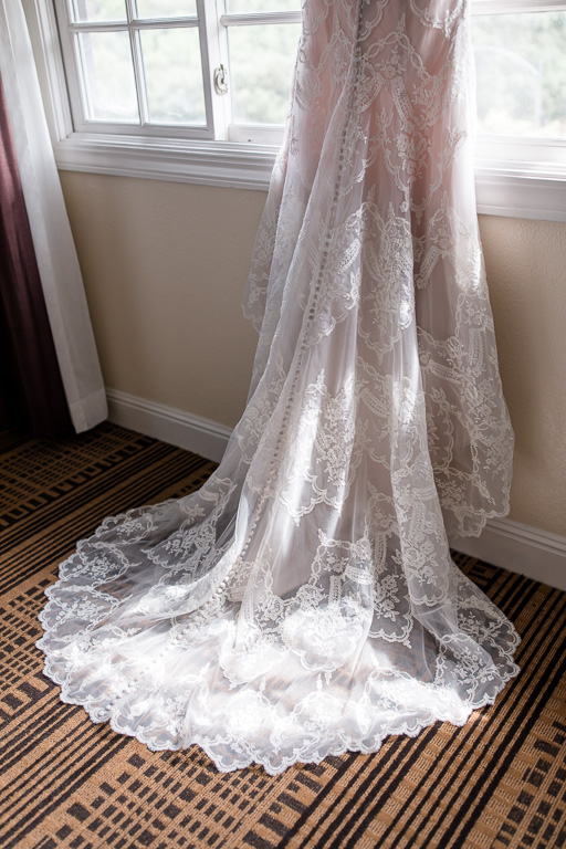 blush lace long train wedding gown
