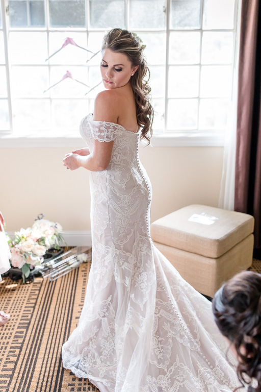bride in her off shoulder A line wedding gown with half up half down hair do