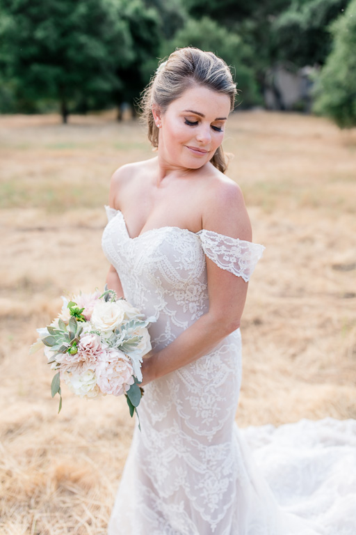 gorgeous bridal portrait on a rolling hill with off shoulder blush wedding gown