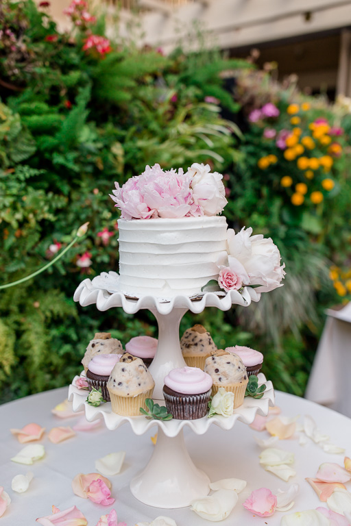 fresh peony cake topper with cupcakes presented at a Toll House Hotel wedding reception
