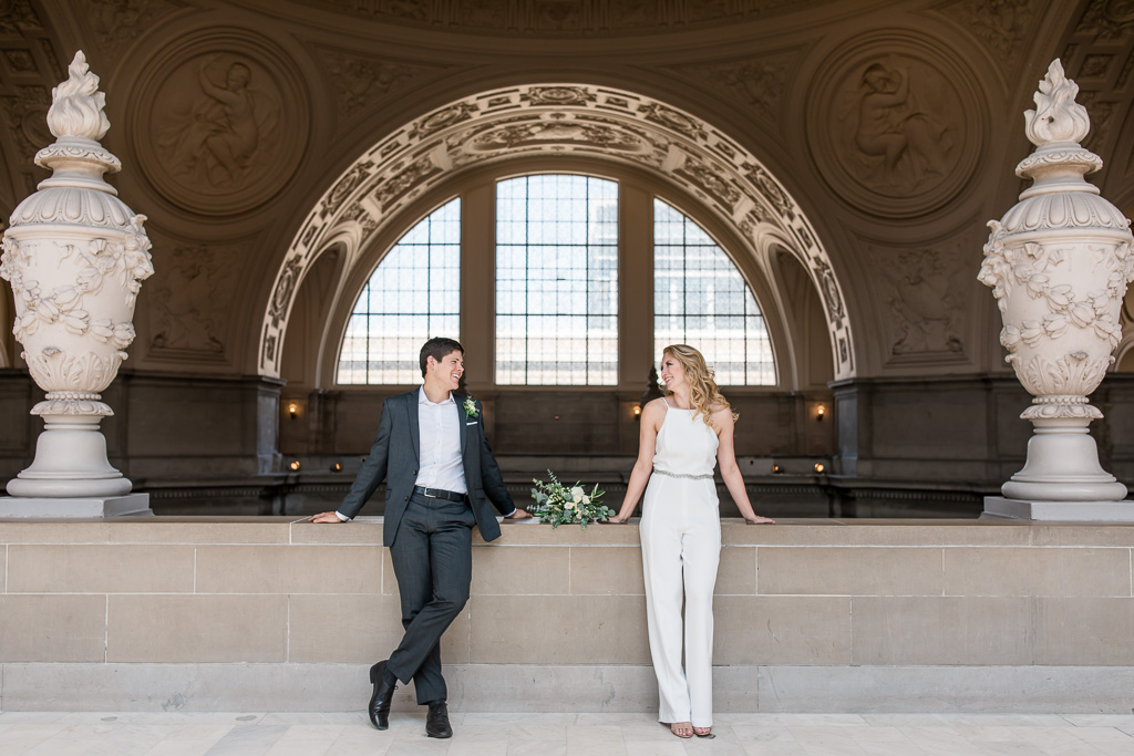stylish wedding portrait at the grand archway in san francisco city hall