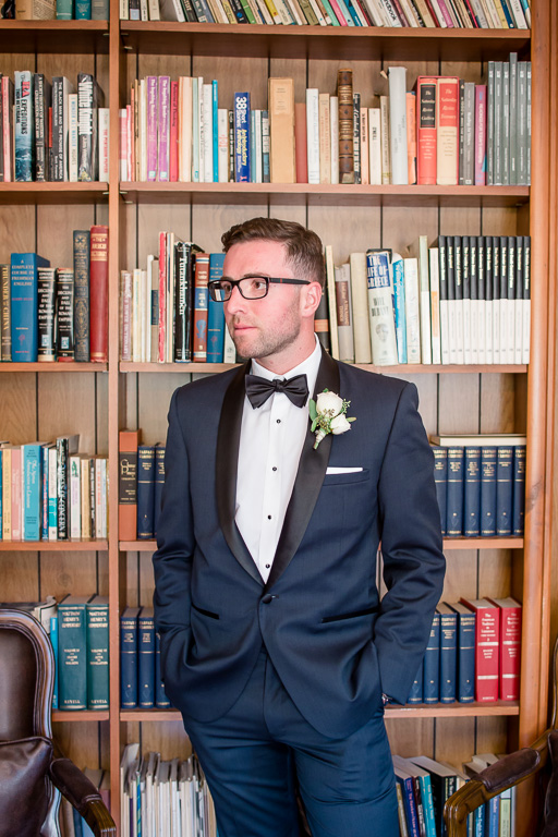 handsome groom at the historic mansion library