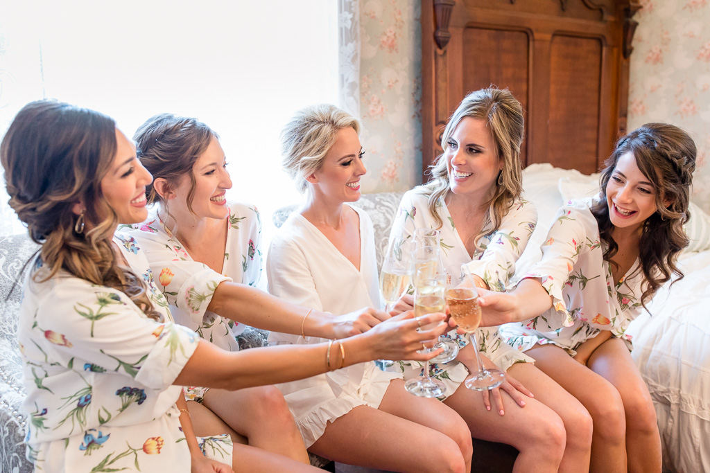 bridesmaids giving a toast to the bride