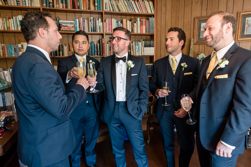 guys doing a toast before the wedding ceremony
