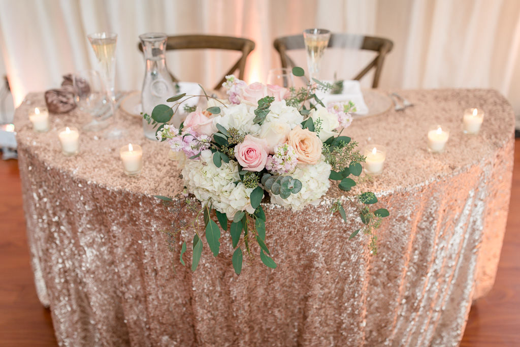 sweetheart table with rose gold sequin tablecloth