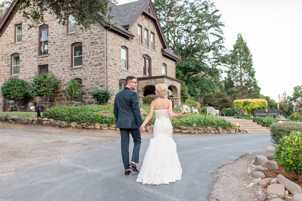 walking to their indoor reception at Elliston Vineyards ballroom