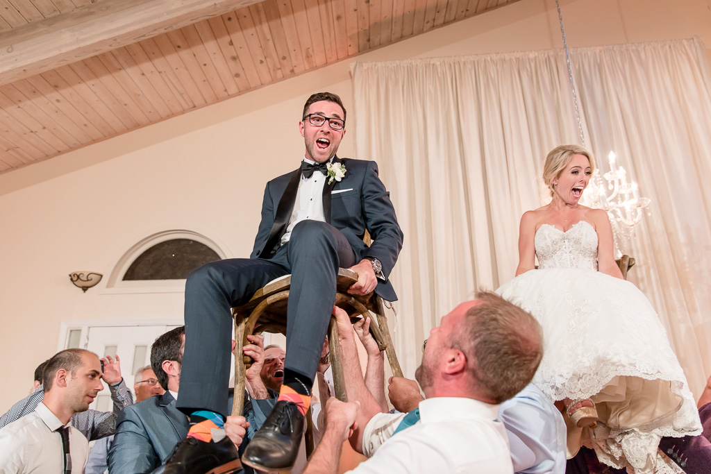 bride and groom hora chair dance at Elliston Vineyards